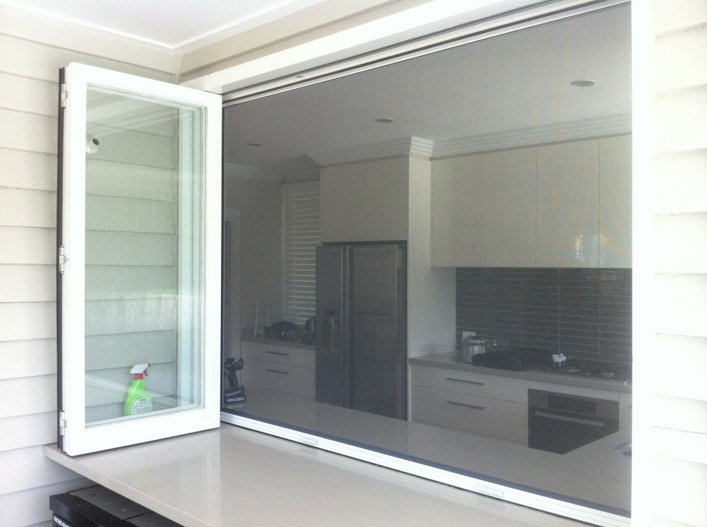 Retractable fly screen on a bi fold servery connect with for Windows with retractable screens