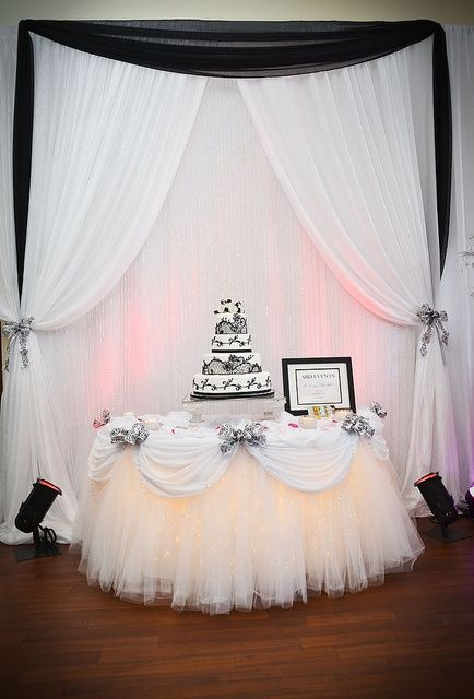 white tulle with black swagger over lay for cake table