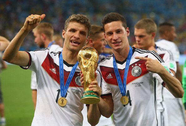 Thomas Mueller Photos Photos Thomas Mueller And Julian Draxler Of Germany Celebrate With The World Cup Trop Germany National Football Team Fifa Thomas Muller