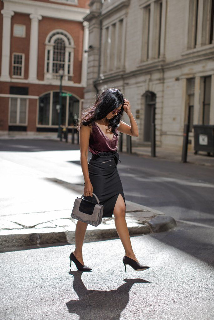 A velvet tank tucked into a fitted skirt and a pair of classic pumps feel right for a work party.