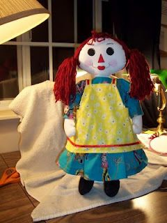 Here she is finished with her apron.    Its been three years since I made this doll and I have another started for my grand daughter who is now a year old.