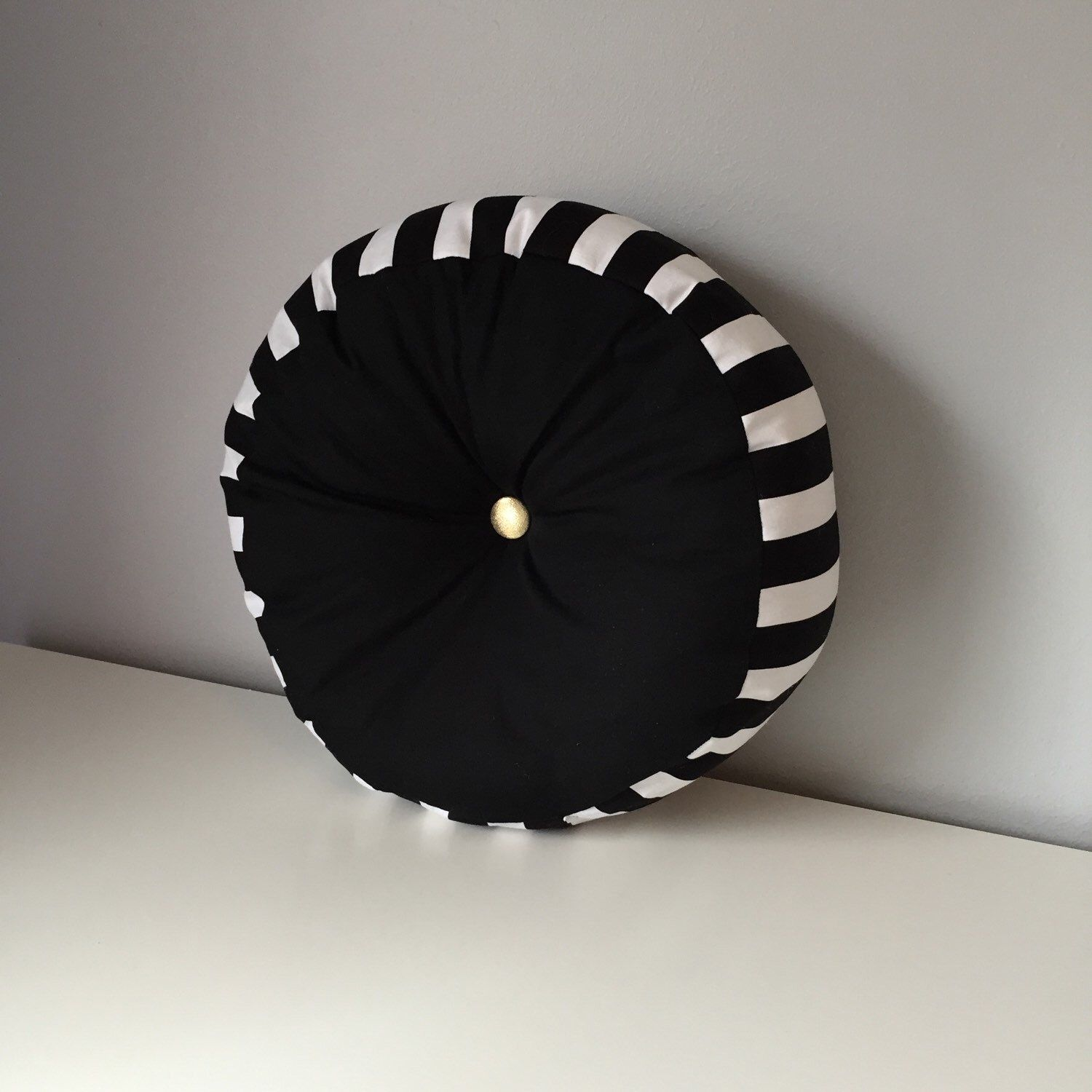 A personal favorite from my Etsy shop https://www.etsy.com/listing/226066598/black-white-stripe-round-pillow-with
