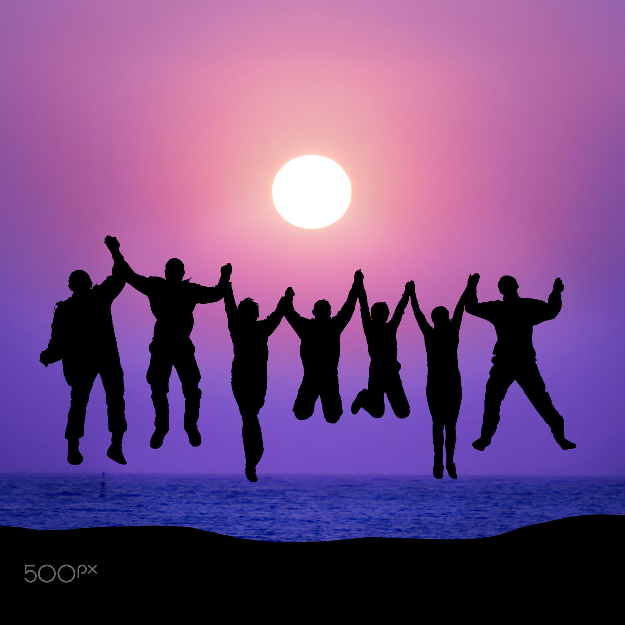 Group Of Friends Jumping Against Sunset