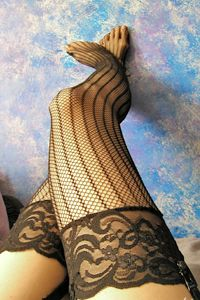 bcc72759f Vertically Striped Fishnet Thigh Highs with Lace Top. One size fits most  90-160 lbs  9