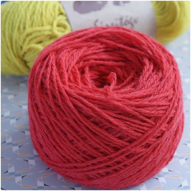 Photo guide on how to wind yarn up by hand so it will stand upright.