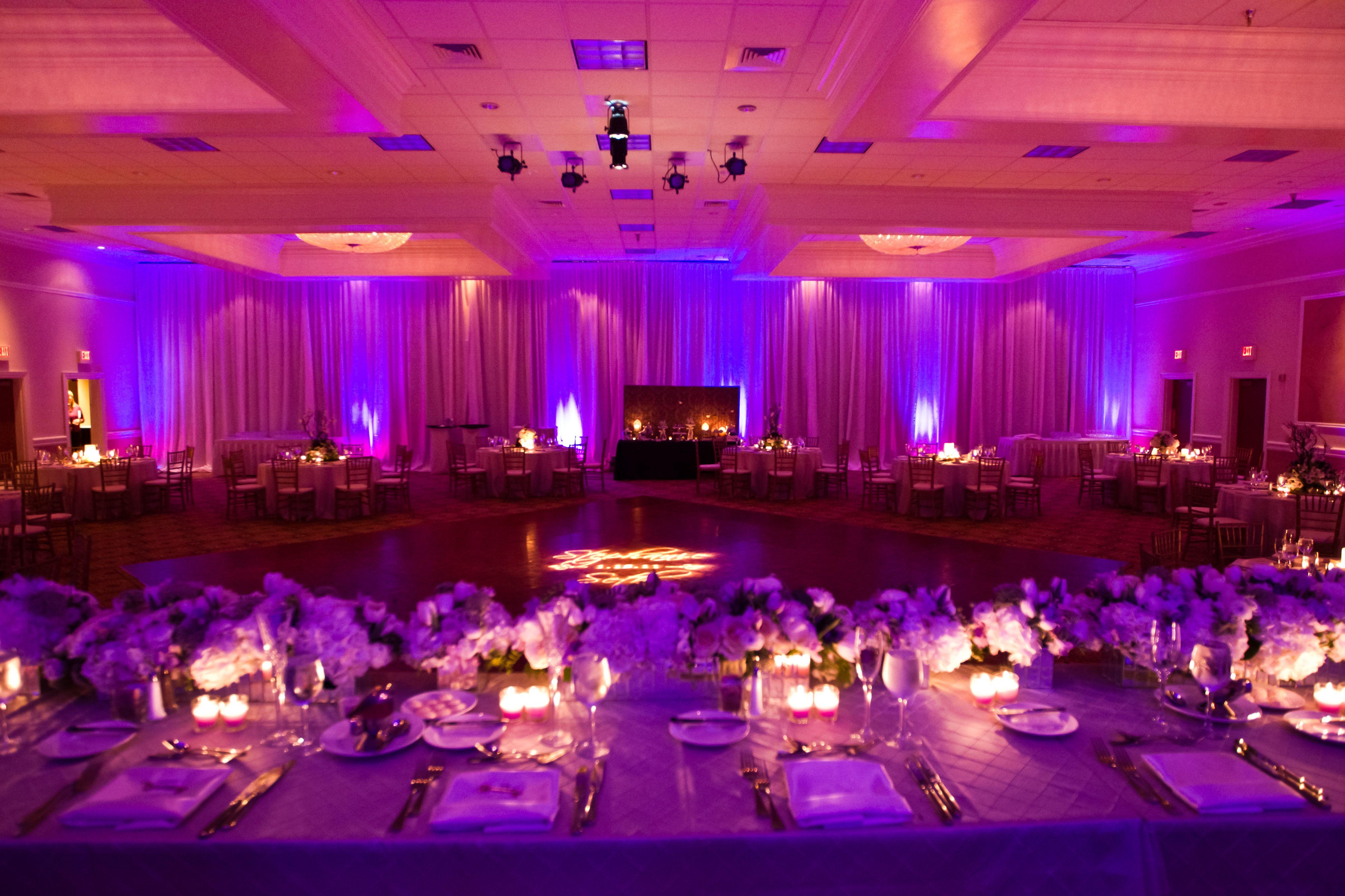 Wedding decorations for hall  burkle events wedding planner  purple wedding reception decor photo