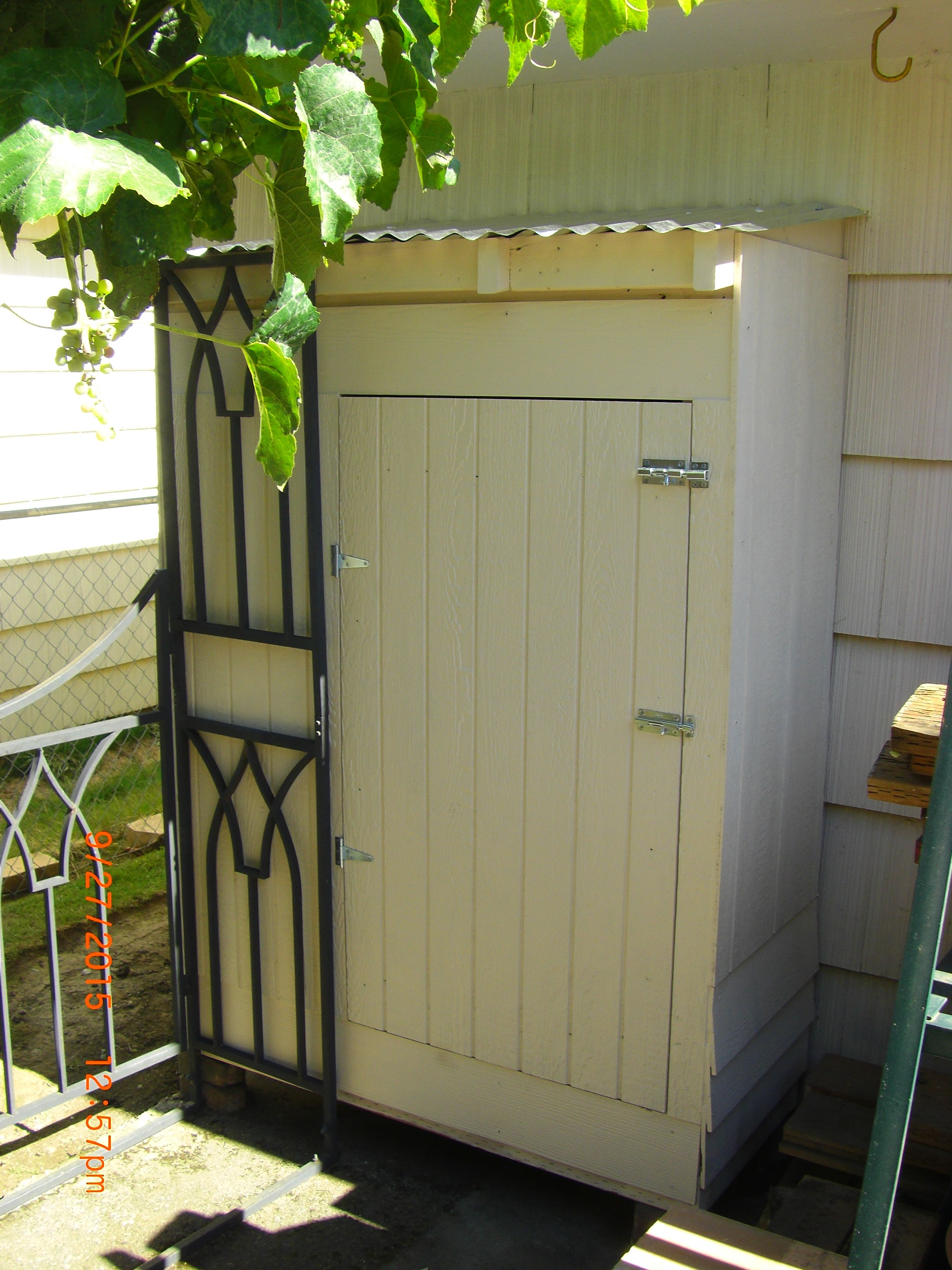 Firewood Shed Built Out Of Scrap Wood & Sheet Metal