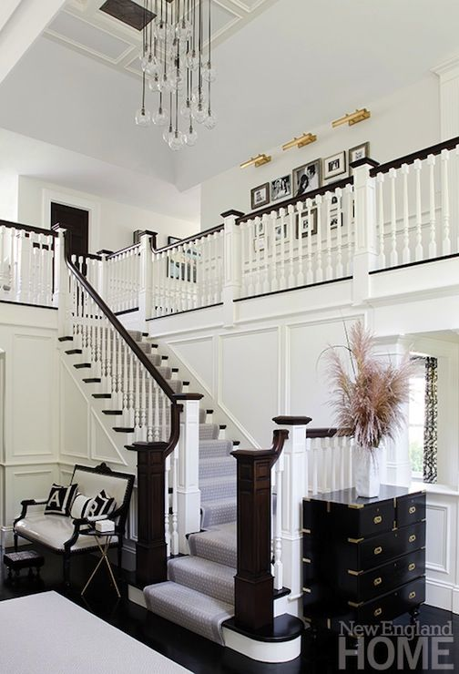 vaulted foyer, wood and white banister, batten and board walls, dark ...