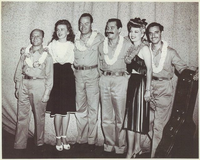 "[Caption from back of photo] -- ""Bob [Hope]'s writer, Barney Dean and dancer Patty Thomas, Bob Hope, comedian, Jerry Colonna, comedian, Frances Langford, singer, Tony Romano (he was our band)."" c.1944-1945. USO Camp Shows, Inc. 