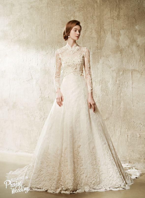 Laced illusion sleeves with high neck design, this Valeria Sposa ...