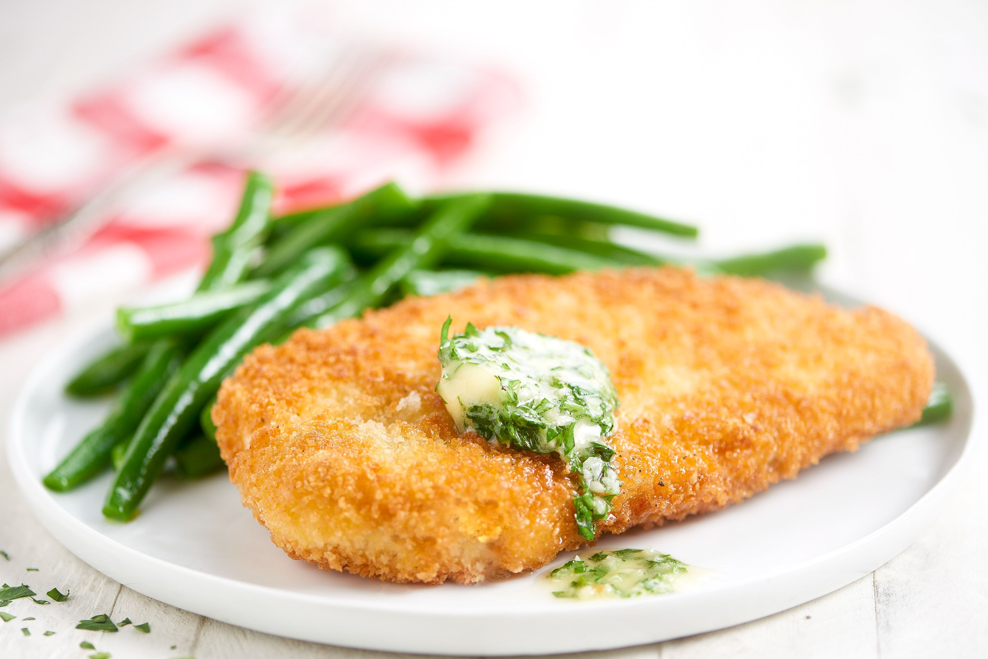 Chicken Kiev with parsleygarlic butter and green beans