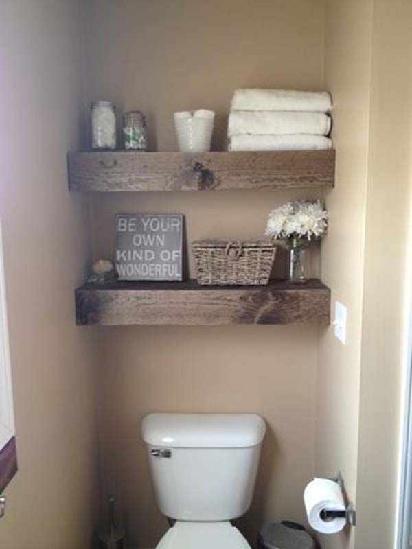 small bathroom shelving. DIY floating shelves for a small space  love how thick the wood these are Perfect half bath Instead of cabinet rustic looking can easily be