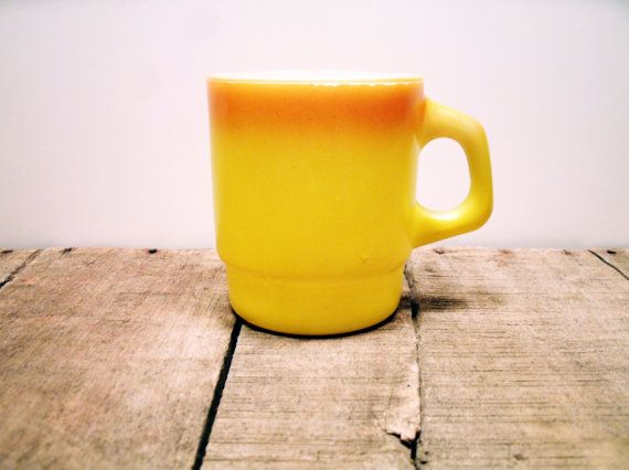 So damn cheerful. The mug for that Morning Person in your life.  Vintage Orange and Yellow Fire King Coffee Mug Cup Glass on Etsy, $6.00
