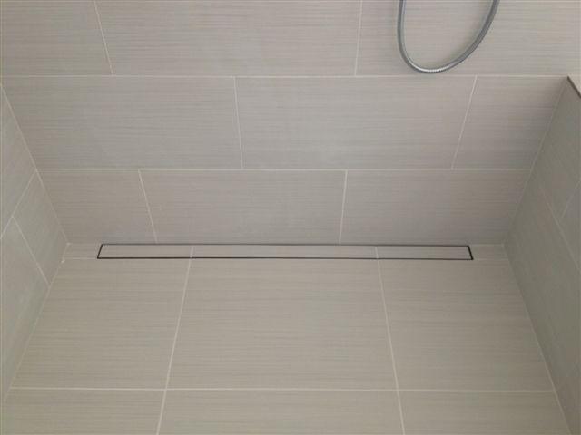 Hidden Drain In The Shower Keeps This Clean Look Hidden Shower Floor Sink Bathroom Inspiration