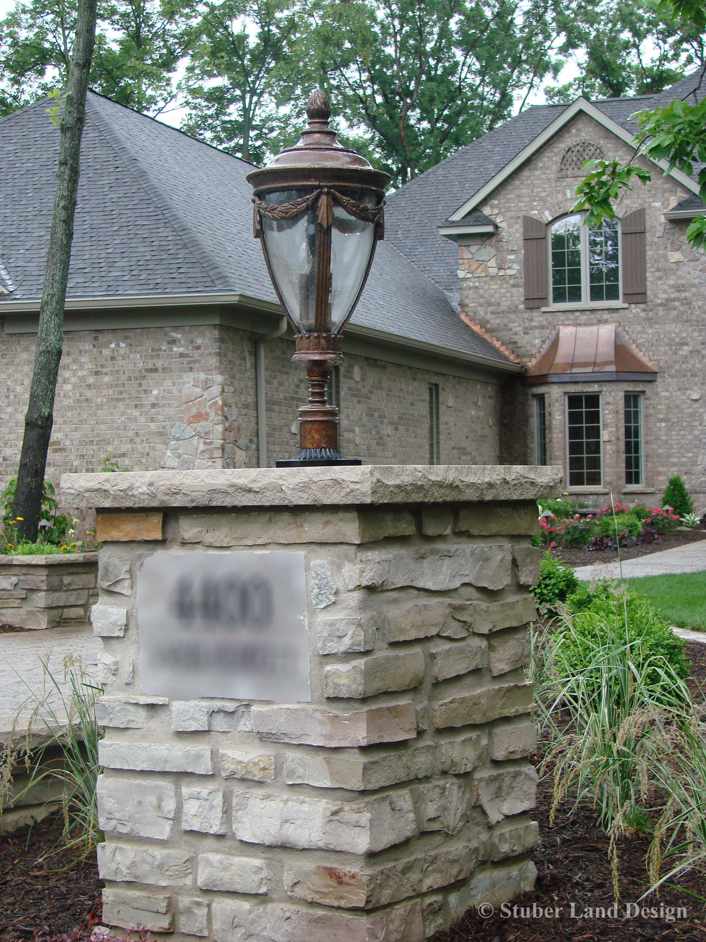 Outdoor Stone Pillars : Natural mortared stone pillar with landscape lighting and