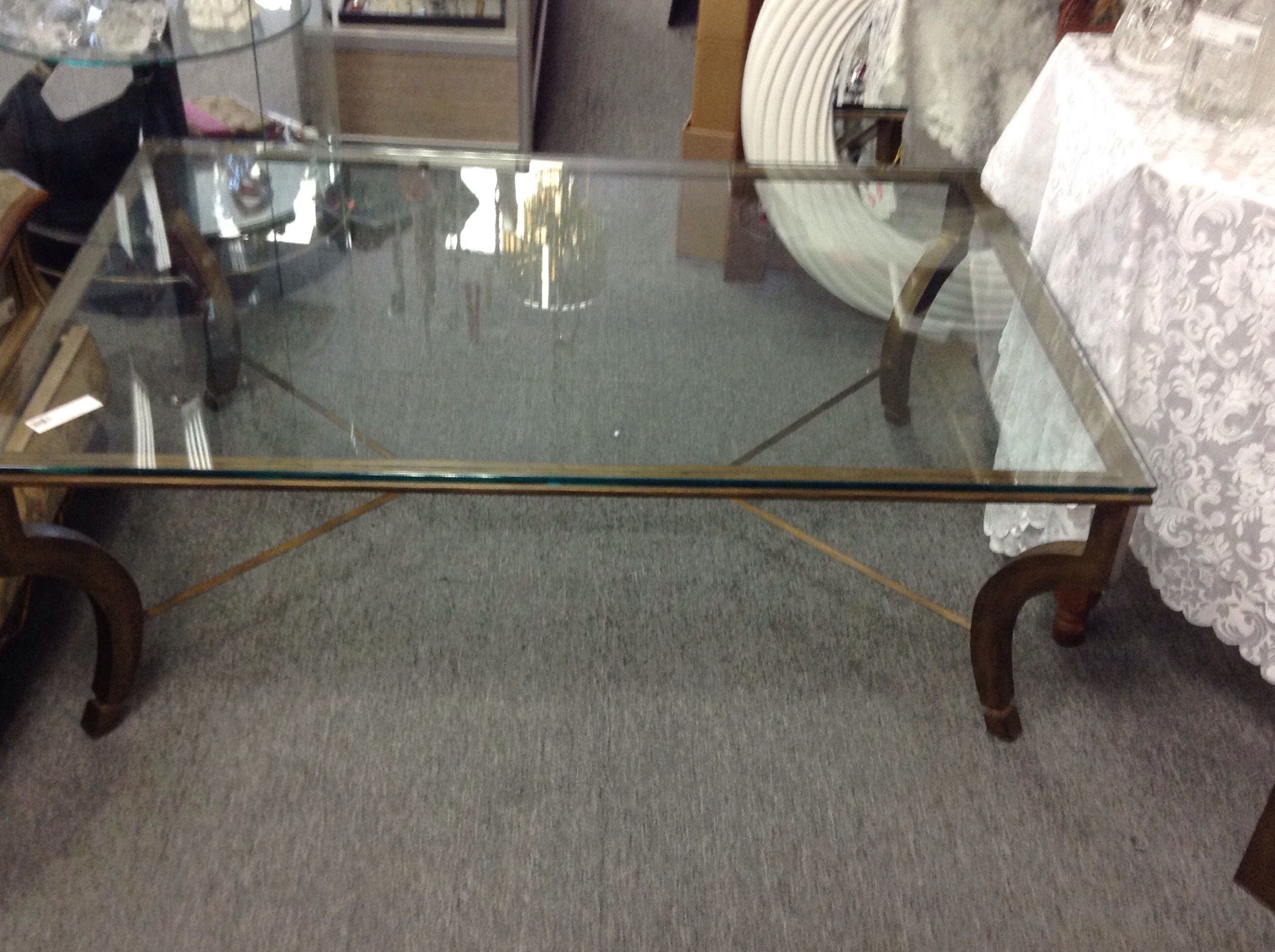 Coffee Table Metallic bronze base with a heavy glass top We