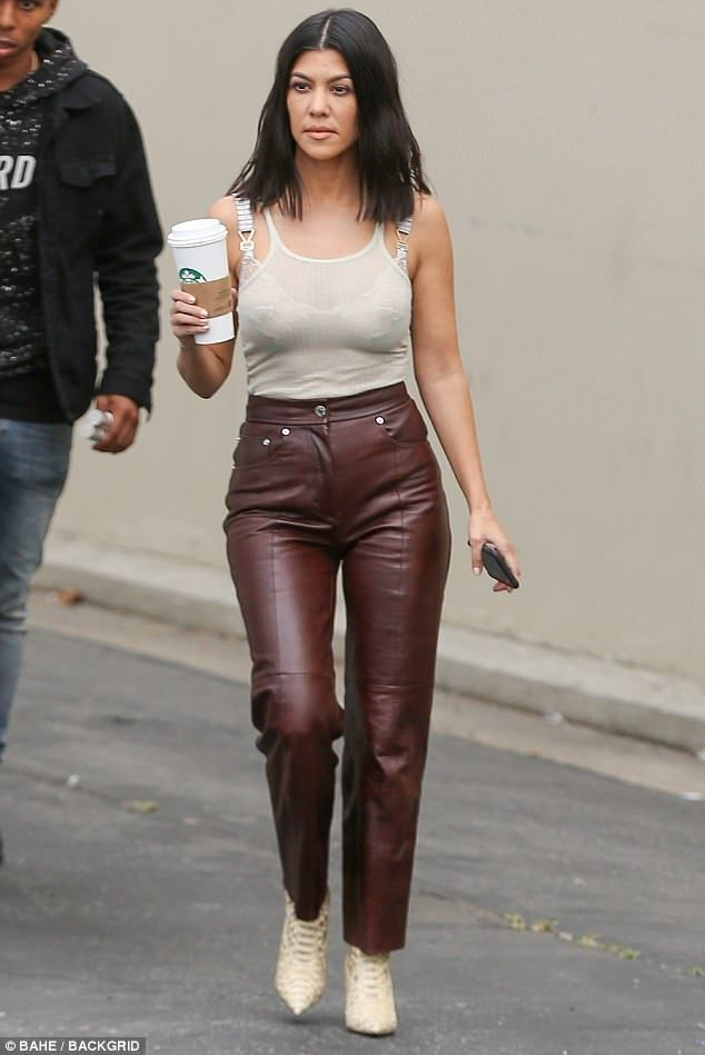 Kourtney Kardashian flaunts figure in leather pants and sheer top
