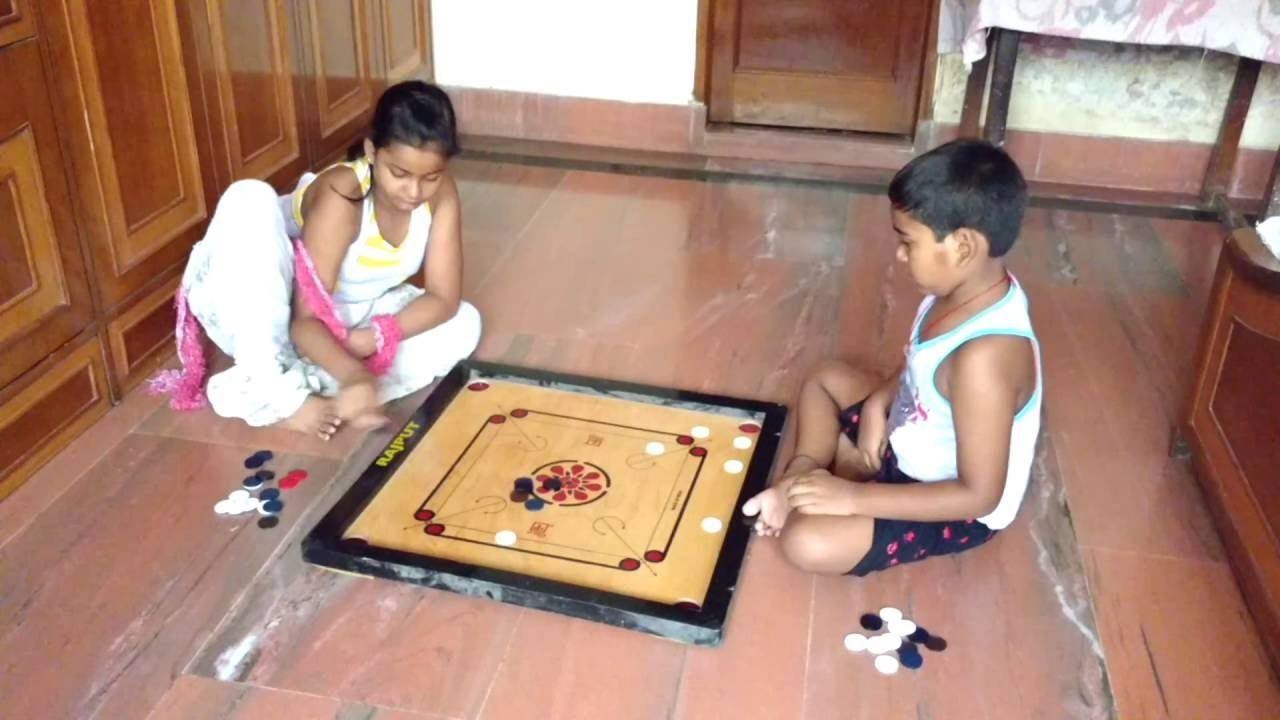 how to play carrom board recreation two kids playing ...