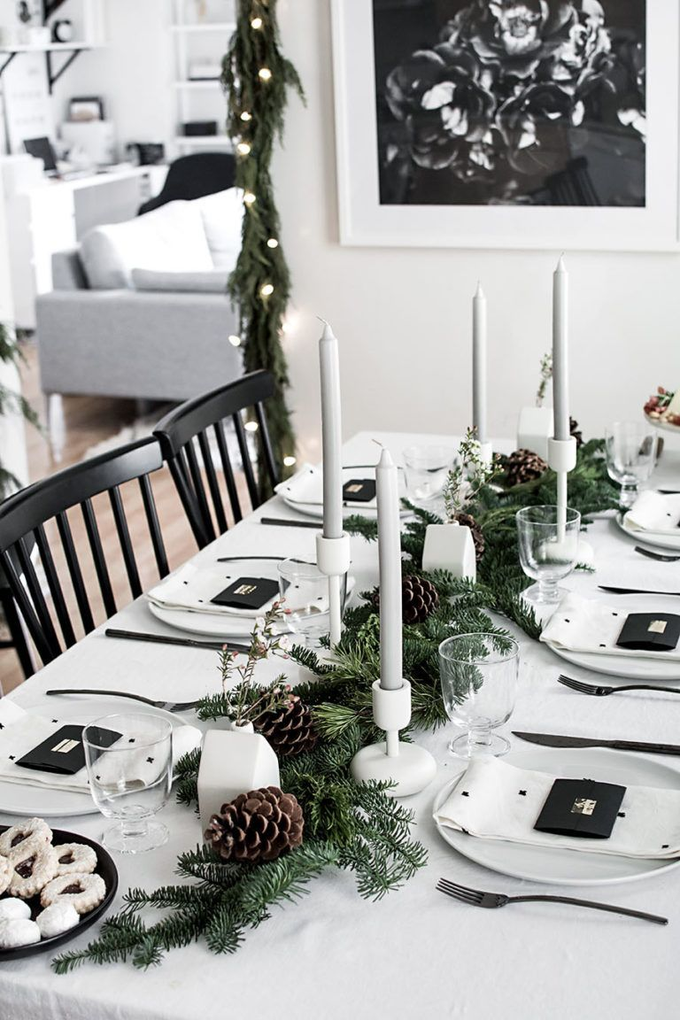 Black And White Christmas Table Decorations Using Candles And Green Garland Holiday Table Decorations Christmas Table Centerpieces Christmas Table
