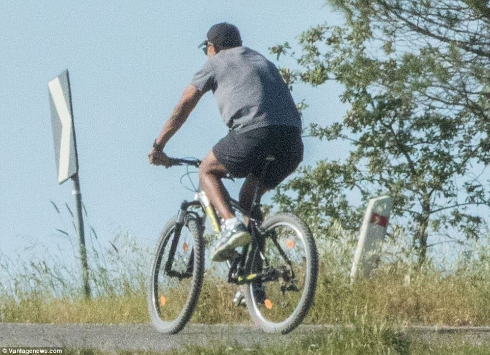 The former president was seen battling up an Italian hill on his mountain bike, wearing a grey T-shirt, shorts, and a baseball cap