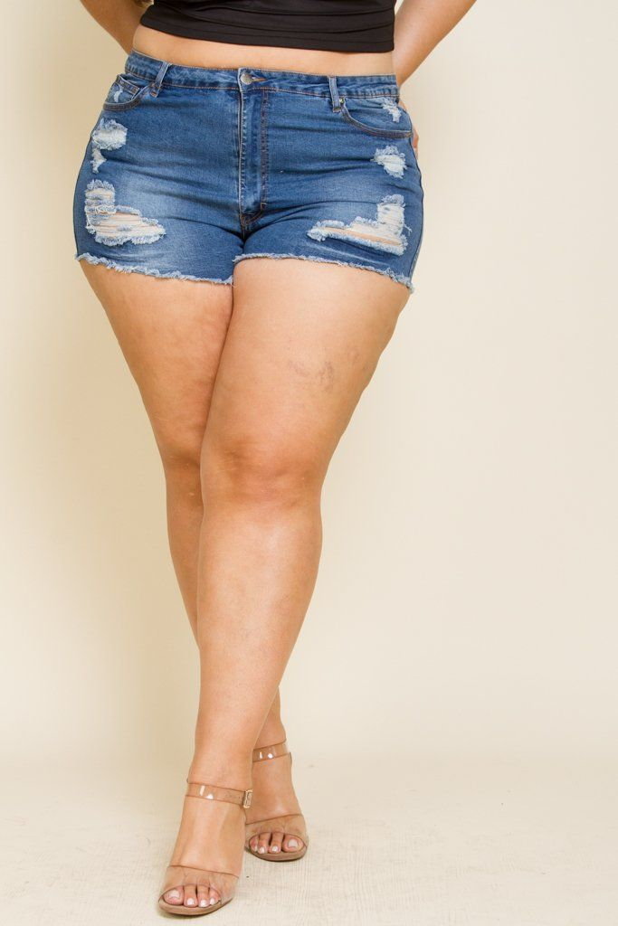 2453152ce0d Plus size denim shorts featuring distressed detailing and mini length.  Model is 6