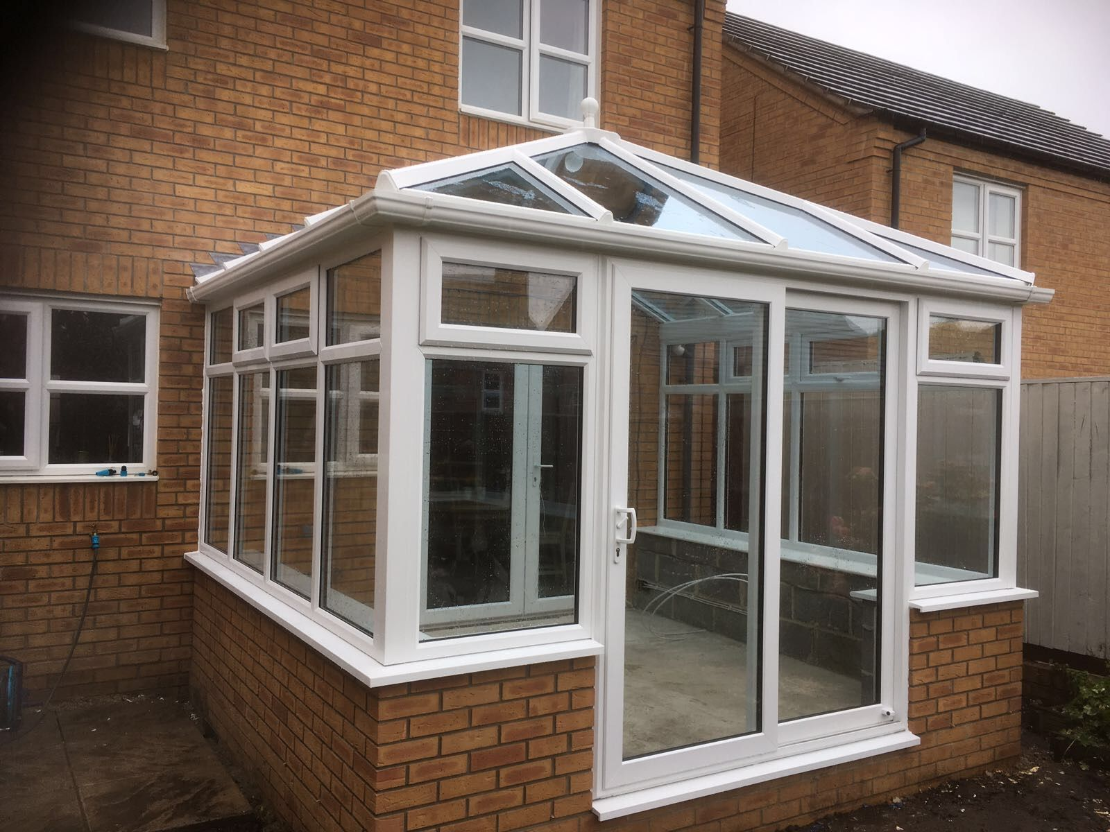 White Synseal Edwardian Style Conservatory With Sliding Patio Doors And Self Cleaning Blue Glass Installed In A Patio Canopy Pergola Plans Sliding Patio Doors