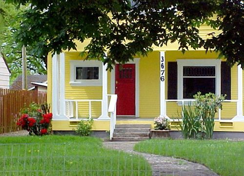 Its Going To Have Be Ger Than This But Yellow With A Red Door And Black Shutters