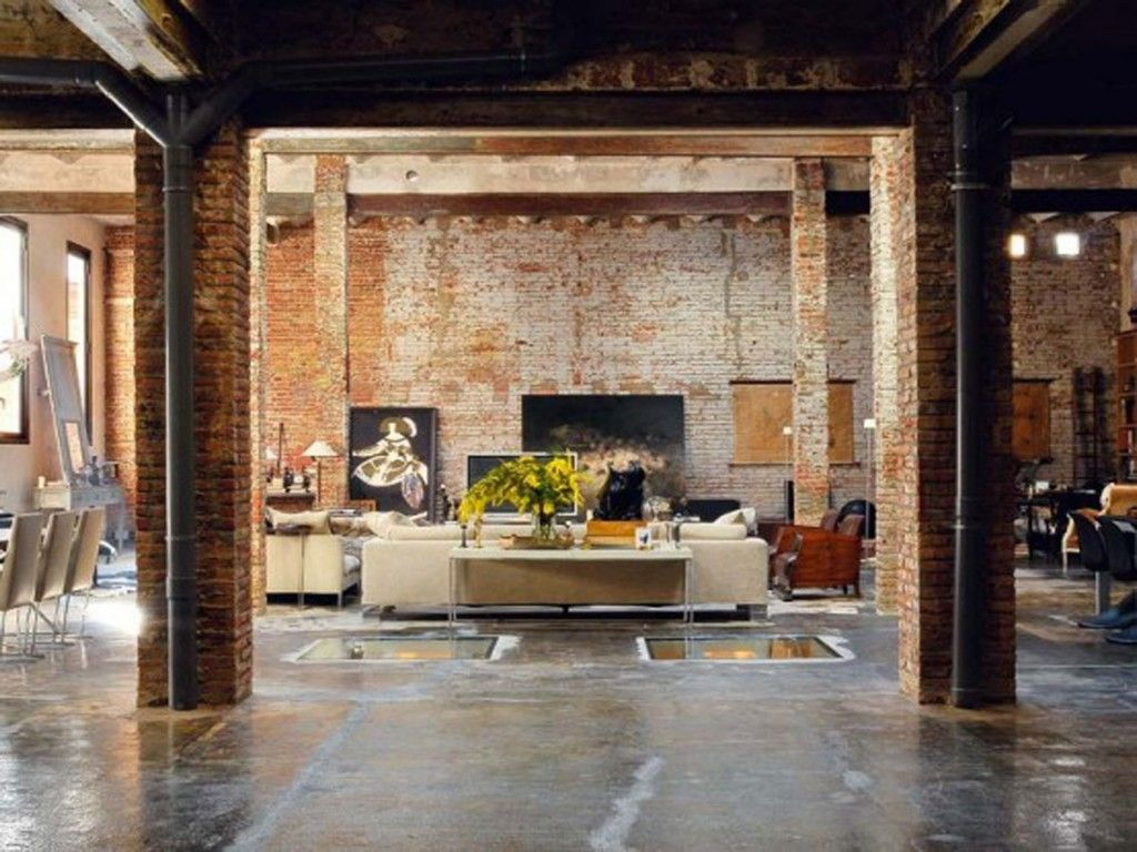 Interior Loft Decorating Ideas With A Room That Has A Large Brick