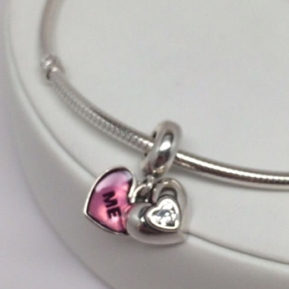 New Pandora You and Me Fuchsia. This is a Brand New Authentic Charm  Comes in Pandora Pouch or paper foldable box.   No Trades. Please.   Visit my Store with over 700 Pandora Items.   All Hallmarked and properly stamped.  If any questions or concerns please drop me a note.   Hard box and bracelet sold Separately.   Thanks and Happy Shopping.   Oh, if you need anything special just let me know and I will do my best to get you what you want. Pandora Jewelry Bracelets
