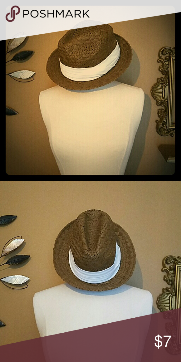 Straw fedora Brown fedora with thick white band twisted on right side. Perfect for warmer weather. Francesca's Collections Accessories Hats