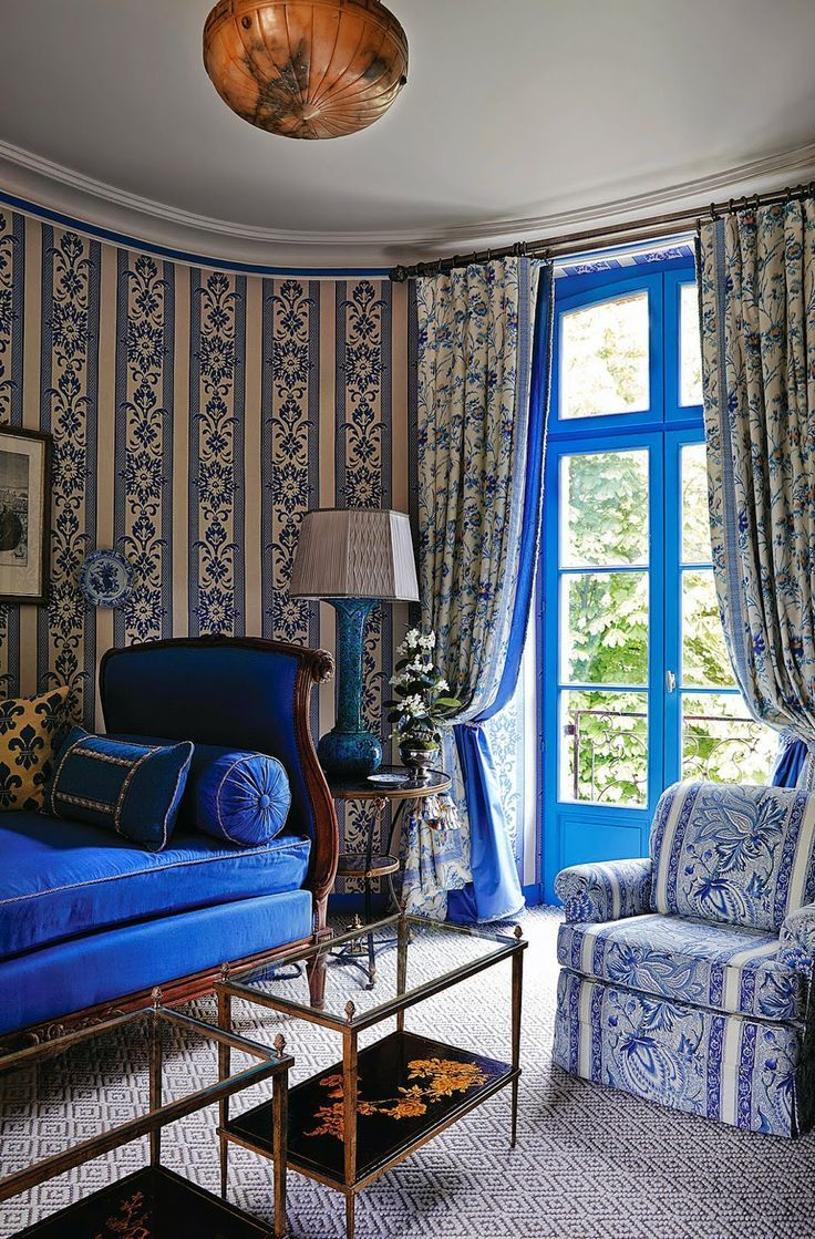 blue and white tower guest room with 18th c. daybed in Juan Pablo Molyneux designed 12th century French chateau