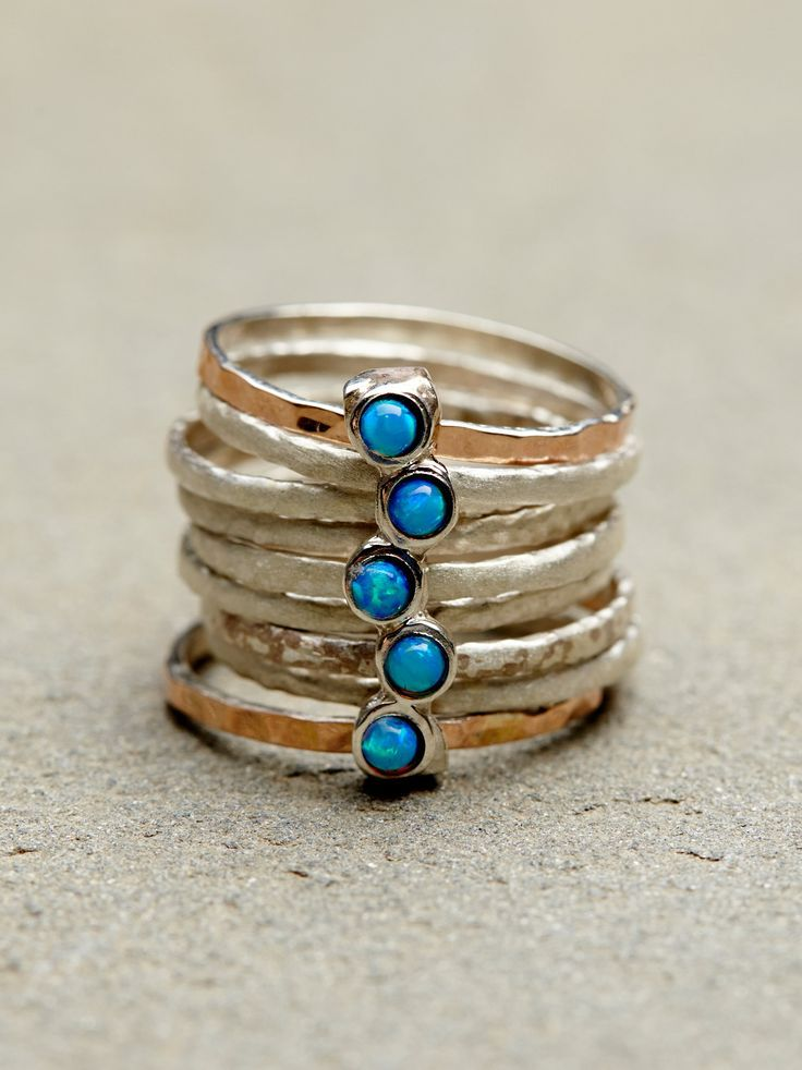 "STACKED TURQUOISE RINGS ""Nine stacked hammered rings held together by a stone charm. Buy here. """