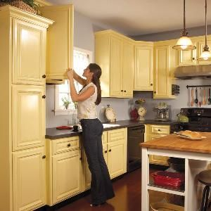 How to Spray Paint Kitchen Cabinets -- just 2 coats + 1 weekend.  How-tos from The Family Handyman.
