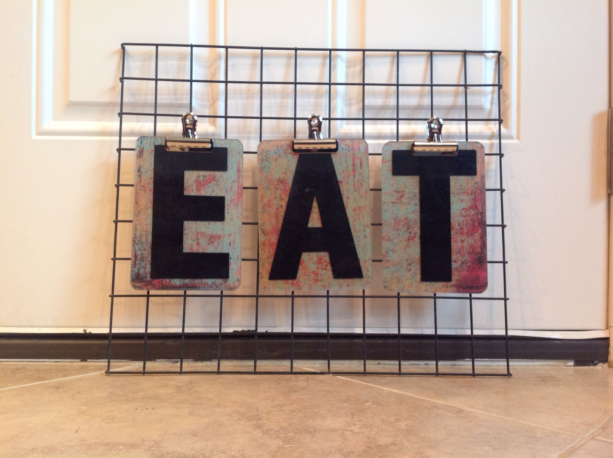 Fun kitchen sign, using plastic marquee letters back with scrapbooking paper, a random wire shelf from a thrift shop, and book clips from a craft store - this is one of my favorite salvage projects I've done!