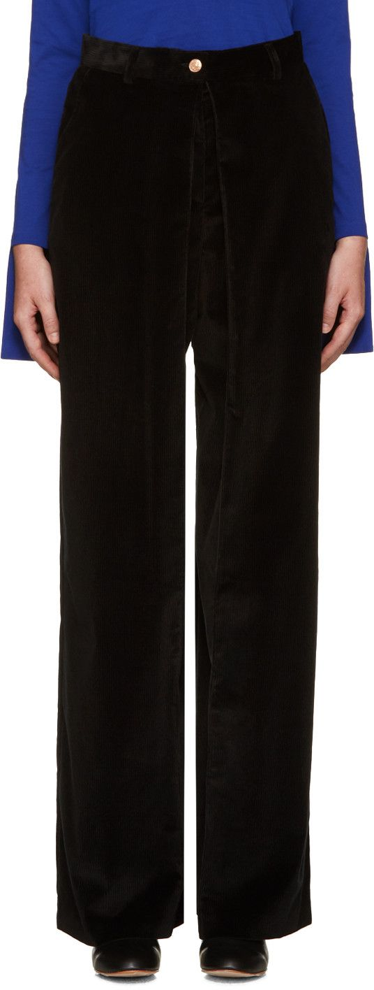 Wide-leg corduroy trousers in black. Four-pocket styling. Deep pleats at front. Zip-fly. Tonal stitching.