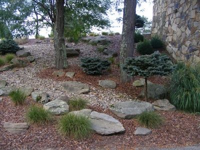 Hillside Landscaping With Rocks And Mulch I Like How It Combines A Hillside Landscaping Landscaping With Rocks Landscaping With Boulders