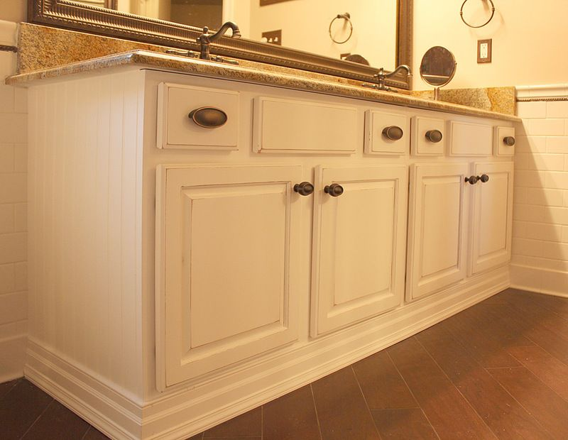 A Distressed Off White Lacquer Finish Transformed That Dowdy Cabinet Into A  Substantial Statement.