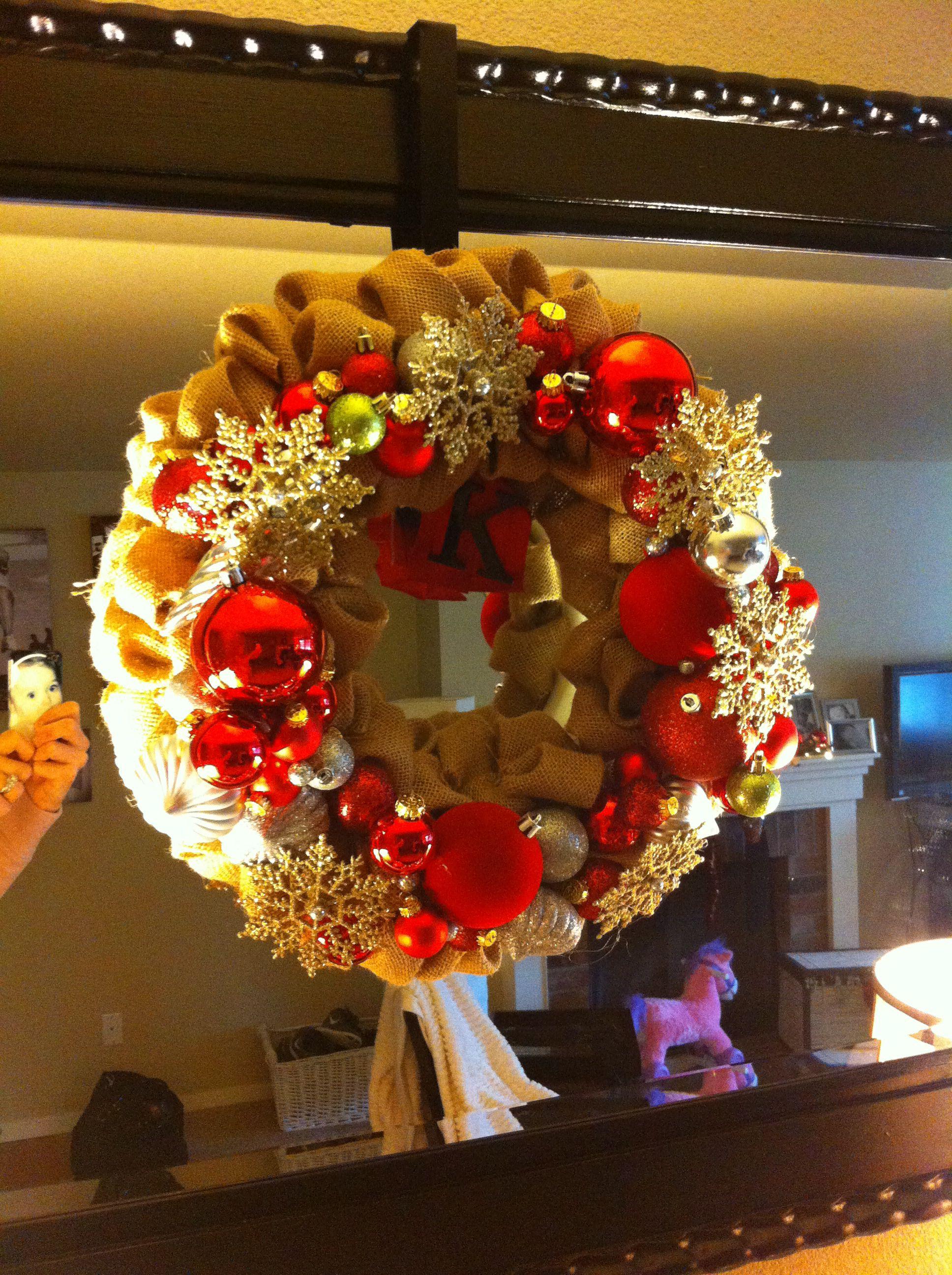 Hot glued old Christmas ornaments onto a burlap wrapped foam wreath ...