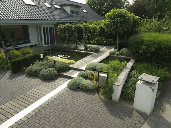 Een groene tuin met weinig onderhoud dat kan green art for Mooie voortuinen foto s
