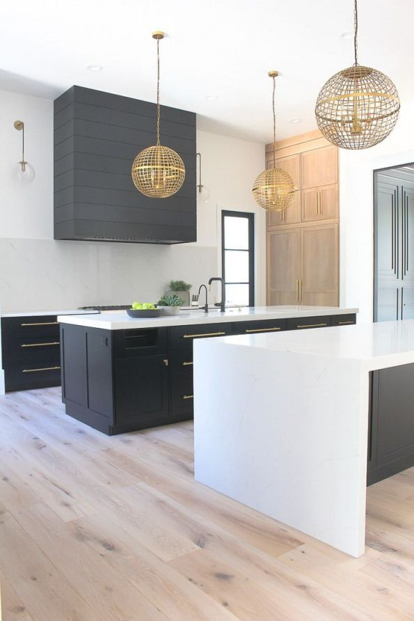 Love #the #concept #of #2 #islands #in #the #kitchen #especially #when #one #has #a #waterfall #countertop! #Love #the #built-ins #and #the #black #color #cabinets. #View #more #on: #New #Modern #Kitchen #from #The #House #of #Silver #Lining # #kitchenfixtures # #kitchen # #fixtures # #waterfallcountertop
