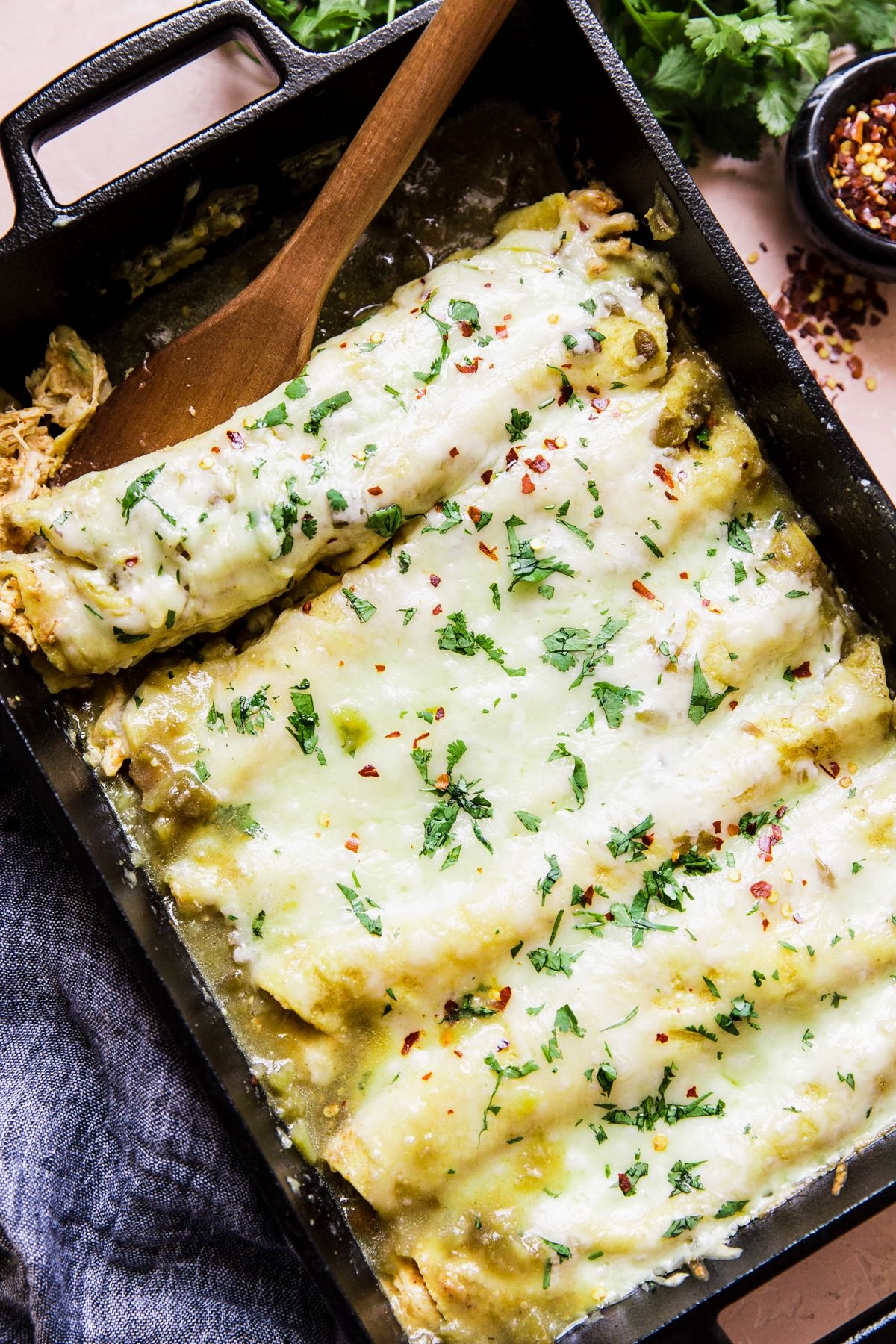 Green Chicken Enchiladas by The Modern Proper. Creamy, cheesy, and so very easy—these comforting chicken enchiladas are slathered in tangy green enchilada sauce and are everything you're craving today (and, let's be honest, every day).