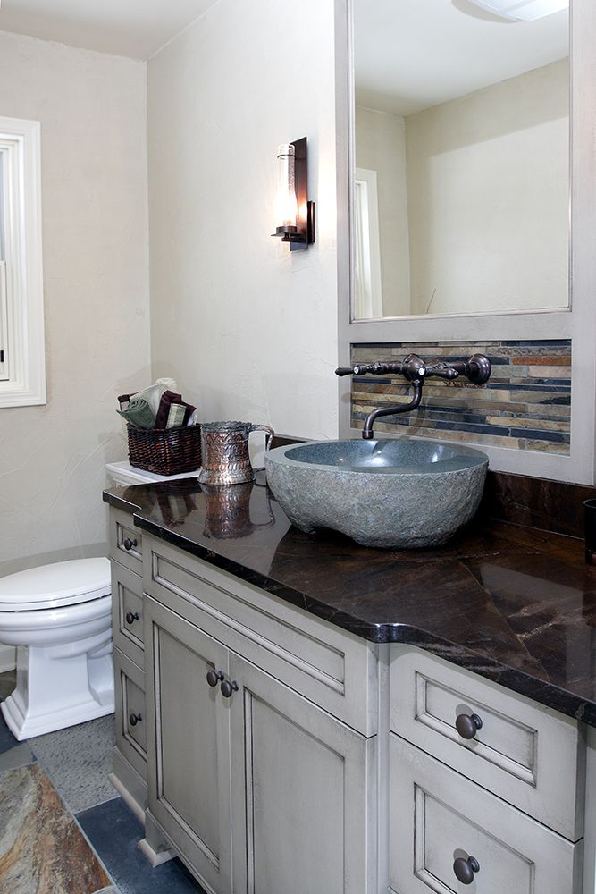The Remodeled Powder Room Features A Custom Vanity, Bronzo Quartzite  Countertop, And Vessel Sink Made From A Boulder.