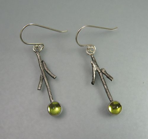 "Branch and twig earrings hand-wrought from sterling silver textured to resemble tree bark and set with peridot - ""Stone Drop Twig Earrings with Peridot"" handcrafted by Kryzia Kreations  http://www.kryziakreationsstudio.com/products/twig-earrings-with-peridot  $115.00"