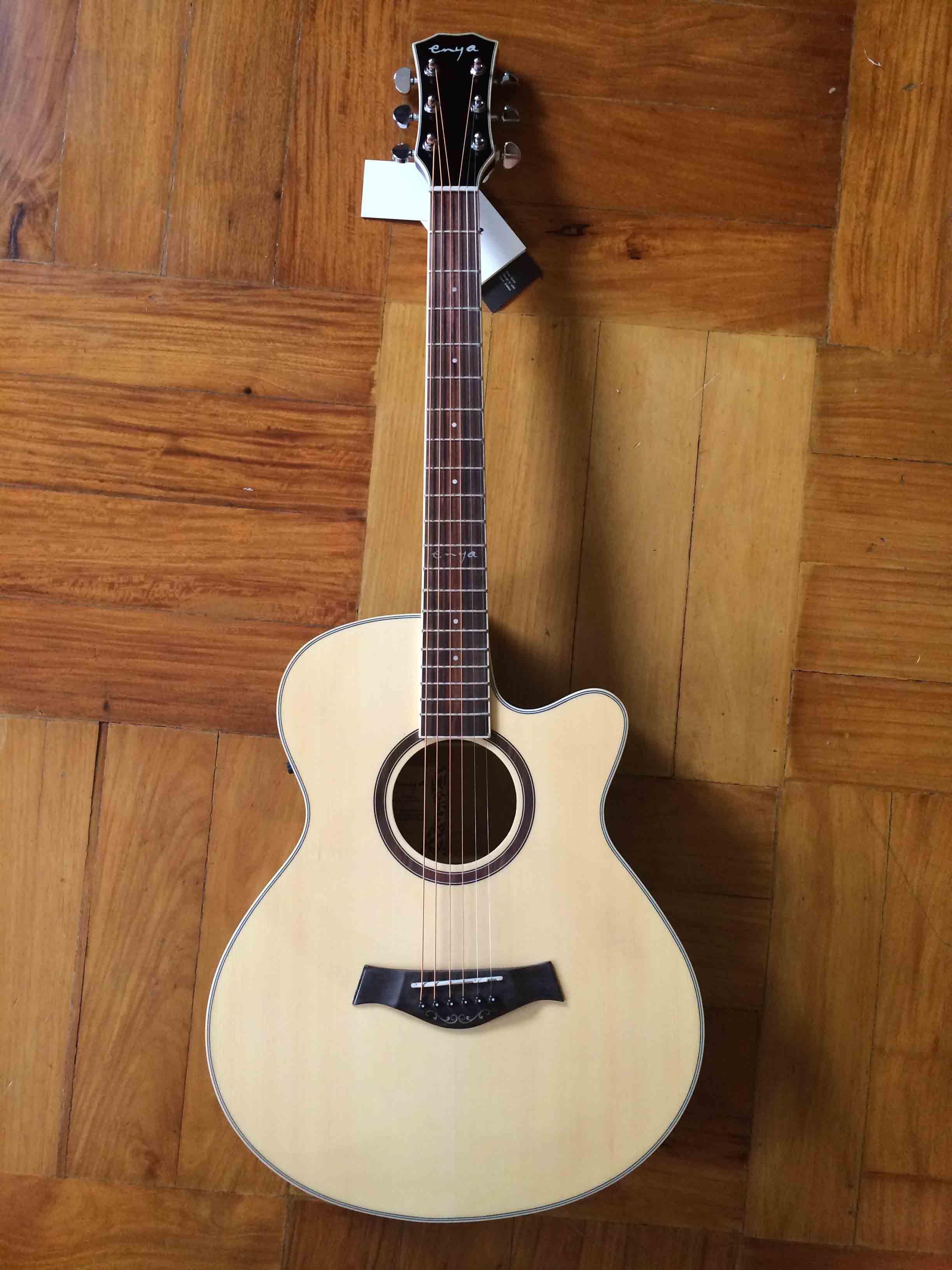 Enya Ef10 Grand Concert Guitar This Is The Enya Ef 10 A Simple Grand Concert Shaped Acoustic Guitar Taylor Guitars Describes The Grand Conce Tudo Sobre Musica