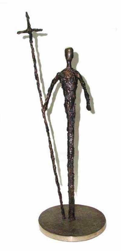 Bronze Religious sculpture by artist Padraic Reaney titled: 'Colmcille (Small Semi Abstract Man and Cross Bronze)' £2167 #sculpture #art