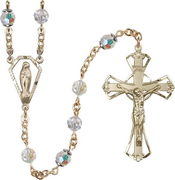 14kt Gold Filled Rosary features 6mm Crystal Swarovski, Austrian Tin Cut Aurora Borealis beads. The Crucifix measures 1 3/4 x 1 1/8. The centerpiece features a