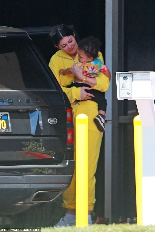 Kylie Jenner cradles baby Stormi as she jets home