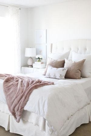 This guest bedroom meets home office is awash in pale blush hues and