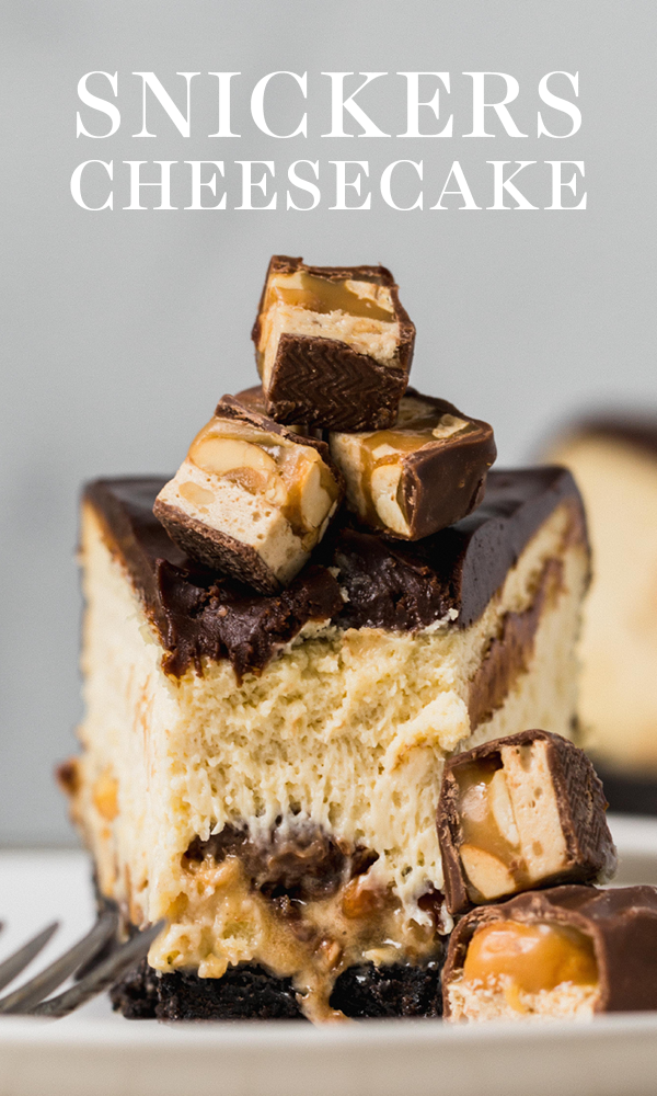 Snickers Cheesecake with Oreo crust, cheesecake filling loaded with Snickers, thick chocolate ganache, and more Snickers on top! Easy recipe! #snickers #cheesecake #cheesecakerecipe #snickerscheesecake