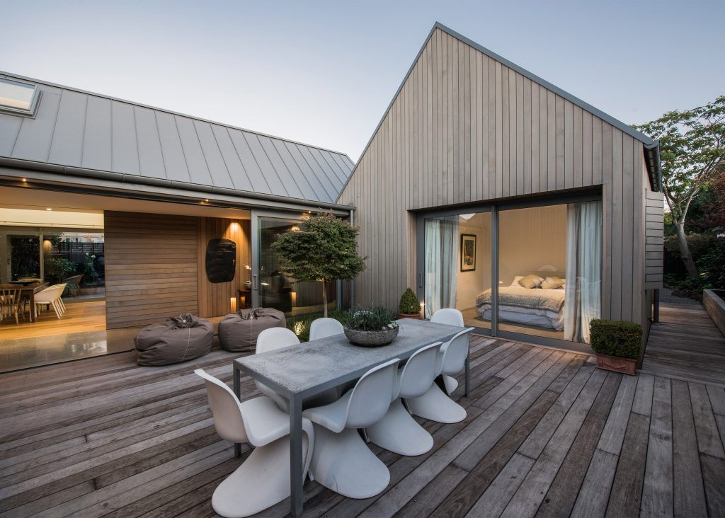 Cedar wood exterior paneling and multiple pitched roofs